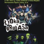 Plakat na koncert Rock Noc. Na czanrym tle zdjęcia występujących zespołów i ich nazwy oraz info o imprezie.